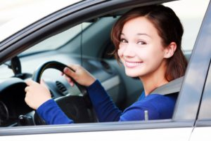 girl inside car smiling