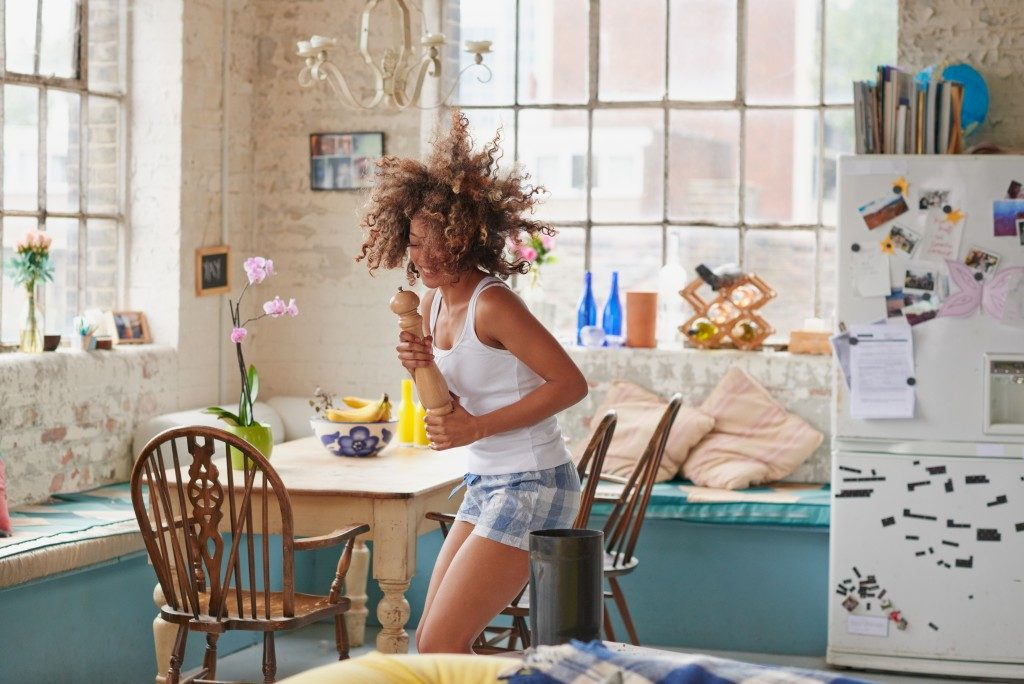 girl dancing in kitchen