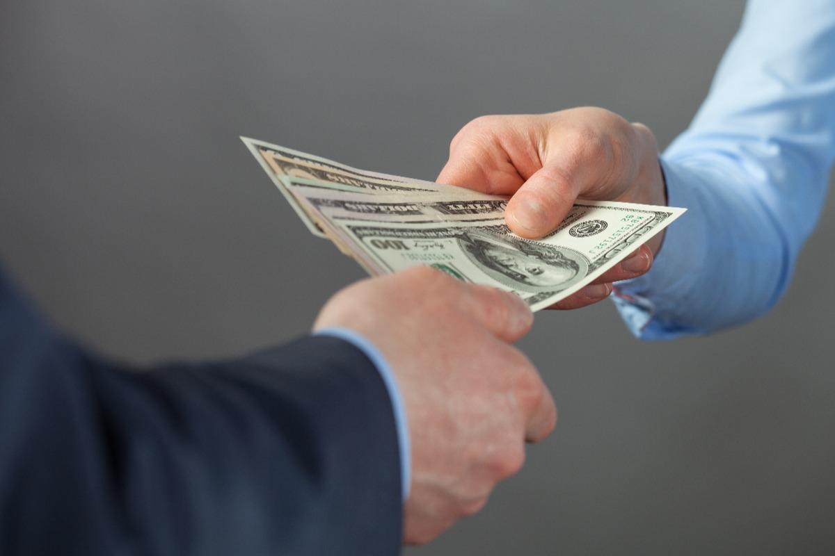 men holding banknotes