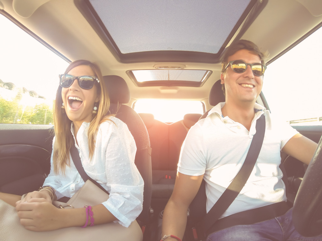 two people being safe and having fun while driving
